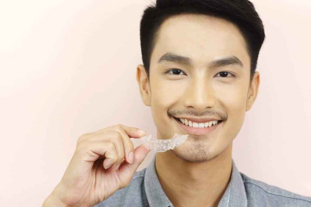 a man with invisalign