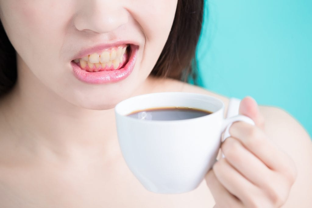 lady drinking coffee causing staining
